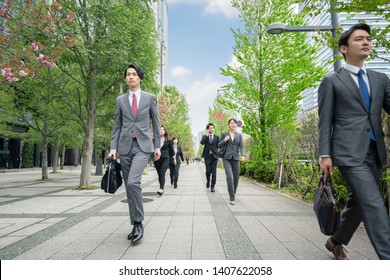 Group of businessperson walking on street.