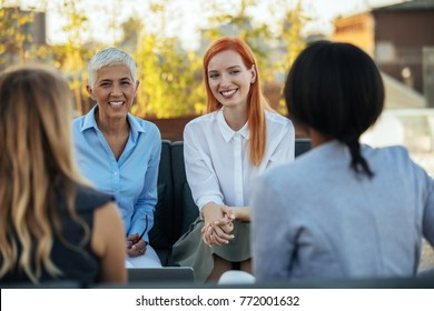 Group of businesswoman having a meeting outdoors
