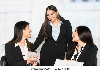 Group of businesswomen working together in an office