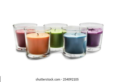 Group of candles in glass candlesticks on white background