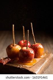 Group of candy apples on rustic board