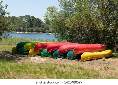 Group of canoes rental kayak on the lake shore beach