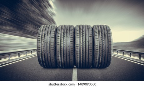 Group of car tires on an asphalt road.