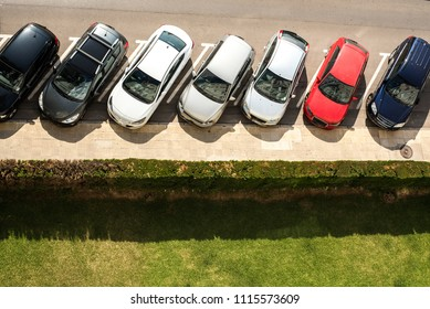 Group of cars parked on the street seen from above