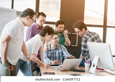 Group of Casual Business meeting to discuss ideas and laptop on table in office.