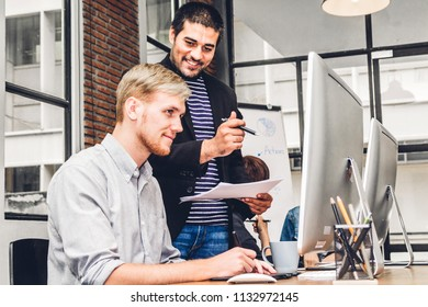 Group of casual business working and discussing strategy with desktop computer.creative business people planning and brainstorm in modern work loft.Teamwork concept