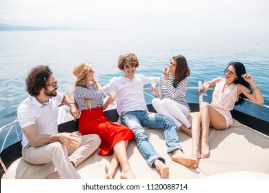 Group of Caucasian high school students participating in sea excursion to picturesque islands along Carribean Sea. Businessor educational travelling on yacht. Cruise vacation.