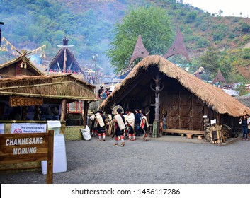 """""""Group of Chakhesang nagas gathered in front of their morung or dormitory - From the 19th Hornbill festival held at Kisama heritage village near Kohima, Nagaland, Northeast India on 3rd December 2018"""""""