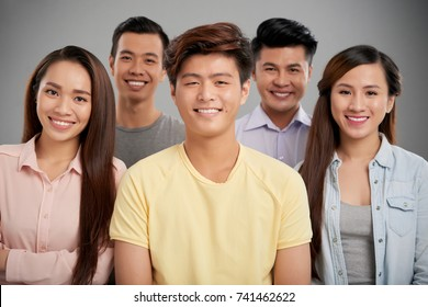 Group of cheerful Asian young people