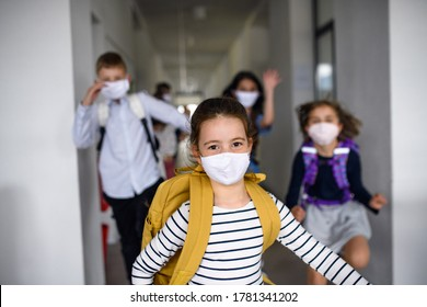 Group of cheerful children going home from school after covid-19 quarantine and lockdown.