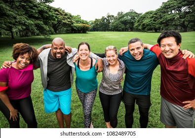 Group of cheerful diverse friends in the park