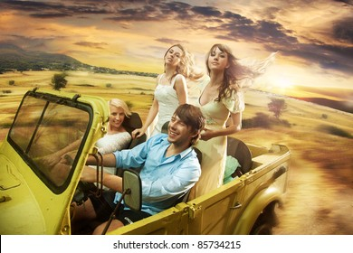Group of cheerful friends driving a cabriolet