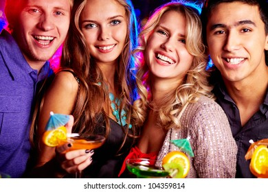 Group of cheerful friends having fun at party