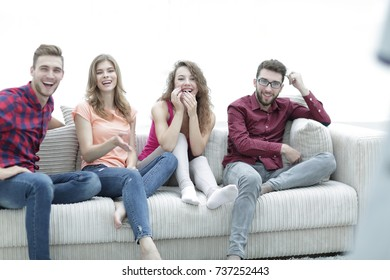 group of cheerful friends watching their favorite movie