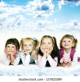 Group of cheerful little girls on a sky background