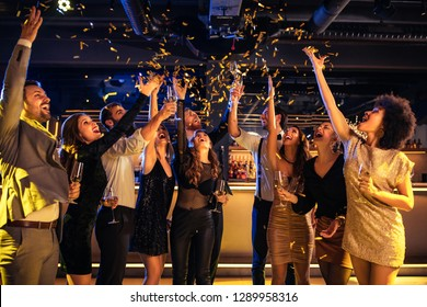Group of cheerful people at the nightclub