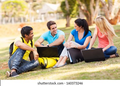 group of cheerful university students relaxing outdoors on campus