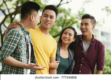 Group of cheerful Vietnamese young people spending time together