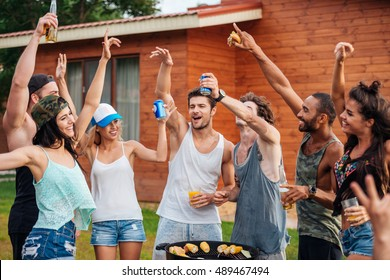 Group of cheerful young friends having fun outdoors