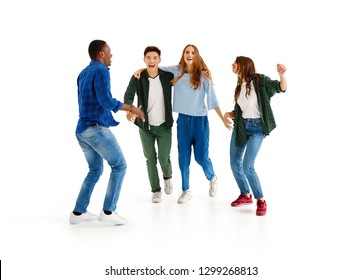 group of cheerful young people men and women multinational isolated on white background