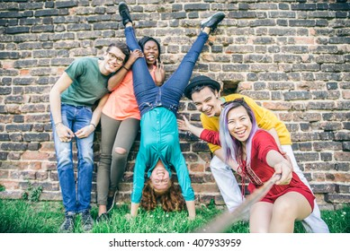 Group of cheerful young people taking a self portrait and having fun outdoors - Happy teens photographing themselves
