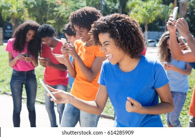 Group of cheering people using 4g with phone