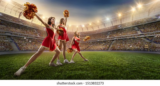 Group of cheerleaders in action on the professional stadium.