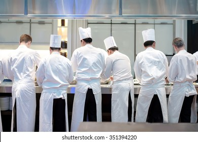 Group chefs busy in commercial kitchen of fine dinning restaurant