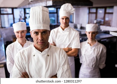Group of chefs standing in kitchen at hotel