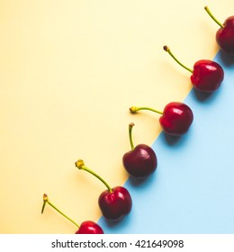 group of cherries on pastel trend background, minimal theme