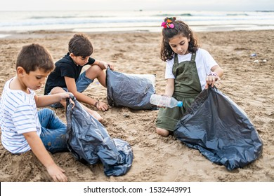 Group of children collecting plastic on a beach