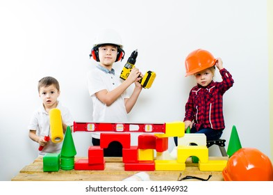 A group of children with construction tools, isolate of white background