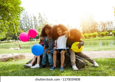 Group of Children are in a Field Trips and playing colorful balloons.