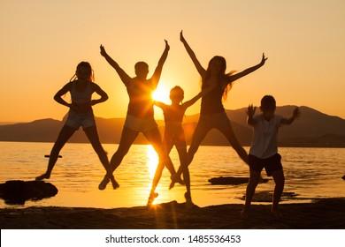 group of children having fun on the ocean