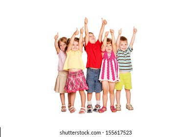 Group of children having fun and showing thumbs up sign or OK symbol. Ready for your text, logo or symbols. Isolated on white background