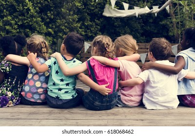 Group of children huddle together in rear view