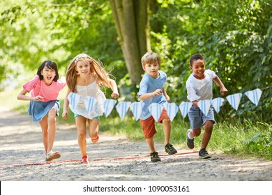 Group children from the international kindergarten makes a race