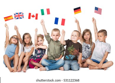 group children, kids holding flags of different countries. German flag, flag england, spain ,america,russia, france flag, canada