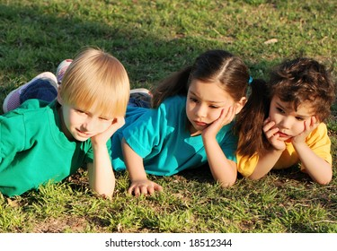 Group of children on a grass in park with the book