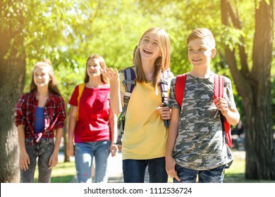 Group of children outdoors on sunny day. Summer camp