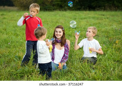Group of children in park doing soap bubbles