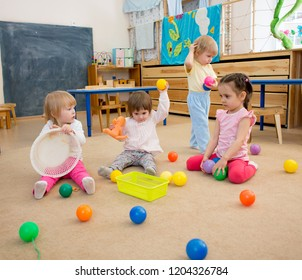 Group of children playing balls in kindergarten or daycare centre