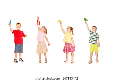 Group of children playing with paper airplanes, holding in hands, starting them fly up,  ready for your text, logo or symbols.Isolated on white background.
