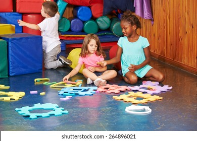 Group of children playing together in a kindergarten