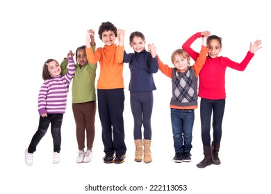 Group of children posing with hands up isolated in white