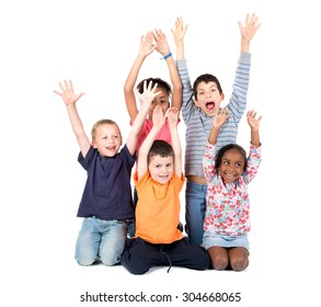 Group of children posing with raised hands isolated in white