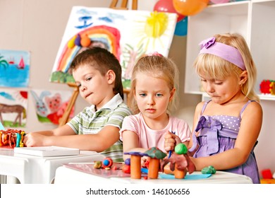 Group of children  in preschool thumb up.