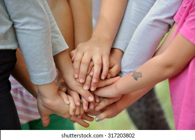 Group of children put their hands together. Teamwork concept.