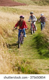 Group Of Children Riding Bikes Through Countryside