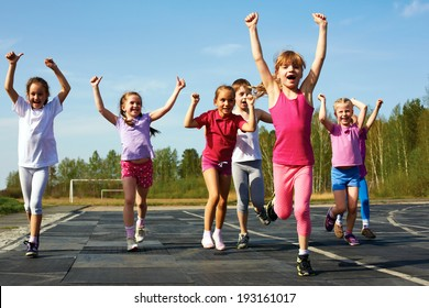 group of children running on the treadmill at the stadium